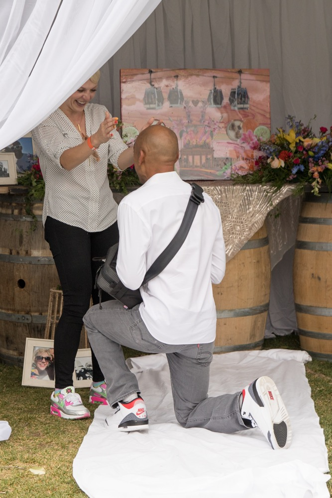 Kat and LeVon Terry engagement at the Vail Wine Festival in Vail Colorado with Toni Axelrod Studios.